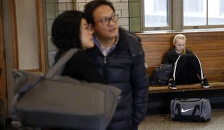 Travelers gather in a waiting room at Amtrak's Baltimore Penn Station, Tuesday, Nov. 20, 2018, in Baltimore. Favorable weather is helping get the Thanksgiving travel rush off to a smooth start. By midday Tuesday, just a few dozen flights had been canceled around the U.S. That's fewer cancelations than many regular travel days. (AP Photo/Patrick Semansky)