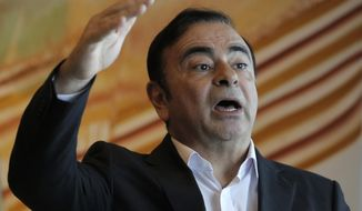 In this Friday, April 20, 2018, photo, Nissan Chairman Carlos Ghosn speaks during an interview in Hong Kong. Ghosn, who became one of the auto industry's most powerful executives by engineering a turnaround at the Japanese manufacturer, was arrested Monday and will be fired for allegedly underreporting his income and misusing company funds, the automaker said. (AP Photo/Kin Cheung)