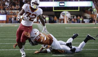 Iowa State running back David Montgomery (32) scores a touchdown past Texas linebacker Gary Johnson (33) during the second half of an NCAA college football game, Saturday, Nov. 17, 2018, in Austin, Texas. (AP Photo/Eric Gay)