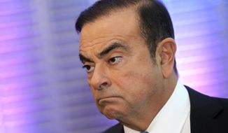In this Oct. 6, 2017, photo, Renault Group CEO Carlos Ghosn listens during a media conference at La Defense business district, outside Paris, France. The arrest of Nissan Motor Co.'s chairman Ghosn on charges he underreported his income and misused company funds caused the company's shares to tumble and shocked many in Japan who view him as something of a hero.  (AP Photo/Michel Euler, File)