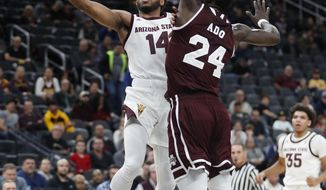 Arizona State's Kimani Lawrence (14) shoots around Mississippi State's Abdul Ado (24) during the first half of a NCAA college basketball game Monday, Nov. 19, 2018, in Las Vegas. (AP Photo/John Locher)