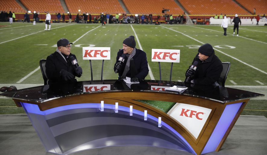 FILE - In this Thursday, Dec. 8, 2016 file photo, announcers from left: Mike Tirico, Tony Dungy and Rodney Harrison work on the set inside Arrowhead Stadium before an NFL football game between the Kansas City Chiefs and the Oakland Raiders, in Kansas City, Mo. When fans tune into NBC's Thanksgiving night broadcast of the Falcons-Saints game, they might do a double take. Rather than seeing Mike Tirico, Tony Dungy and Rodney Harrison in the studio for the pregame and halftime programs, those three gentlemen will be calling the game. (AP Photo/Charlie Riedel, File)