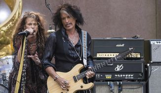"In this Aug. 15, 2018, file photo, Steven Tyler, left, and Joe Perry of Aerosmith perform on NBC's ""Today"" show at Rockefeller Center in New York. Perry has cancelled his fall tour to take time off after recently being hospitalized with breathing problems. The Aerosmith guitarist's publicist said in a statement Tuesday, Nov. 20, 2018, the 68-year-old will take the rest of the year off. He had expected to return to the road starting Nov. 30 through Dec. 16. (Photo by Charles Sykes/Invision/AP, File)"