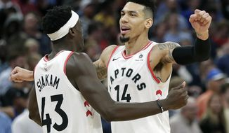 Toronto Raptors' Danny Green (14) celebrates his game winning shot against the Orlando Magic with teammate Pascal Siakam (43) in the final seconds of an NBA basketball game, Tuesday, Nov. 20, 2018, in Orlando, Fla. (AP Photo/John Raoux)