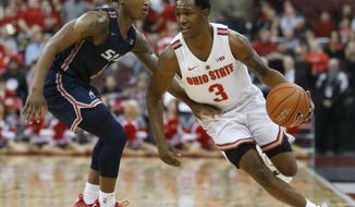 Ohio State's C.J. Jackson, right, brings the ball up court against Samford's Josh Sharkey during the second half of an NCAA college basketball game Tuesday, Nov. 20, 2018, in Columbus, Ohio. Ohio State beat Samford 68-50. (AP Photo/Jay LaPrete)
