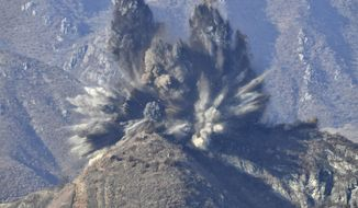 In this photo provided by South Korea Defense Ministry, smoke from an explosion rises at a North Korean guard post in North Korea, is seen from South Korea, Tuesday, Nov. 20, 2018. North Korea on Tuesday blew up some of its front-line guard posts as part of an agreement to ease tensions along its heavily fortified border with South Korea, Seoul's Defense Ministry said. (South Korea Defense Ministry via AP)