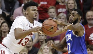 Indiana's Juwan Morgan and Texas-Arlington's Tiandre Jackson-Young battle for a loose ball during the first half of an NCAA college basketball game, Tuesday, Nov. 20, 2018, in Bloomington, Ind. (AP Photo/Darron Cummings)