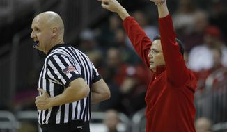 Nebraska head coach Tim Miles motions to his players during the first half of an NCAA college basketball game against Texas Tech Tuesday, Nov. 20, 2018, in Kansas City, Mo. (AP Photo/Charlie Riedel)