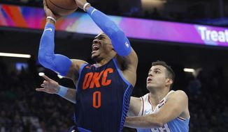 Oklahoma City Thunder guard Russell Westbrook (0) drives to the basket against Sacramento Kings forward Nemanja Bjelica (88) during the first half of an NBA basketball game in Sacramento, Calif., Monday, Nov. 19, 2018. (AP Photo/Steve Yeater)