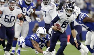 Tennessee Titans quarterback Marcus Mariota (8) runs out of a tackle by Indianapolis Colts' Jabaal Sheard (93) during the first half of an NFL football game, Sunday, Nov. 18, 2018, in Indianapolis. (AP Photo/Michael Conroy)