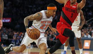 New York Knicks guard Trey Burke (23) drives to the basket past Portland Trail Blazers guard CJ McCollum (3) during the first half of an NBA basketball game Tuesday, Nov. 20, 2018, in New York. (AP Photo/Adam Hunger)