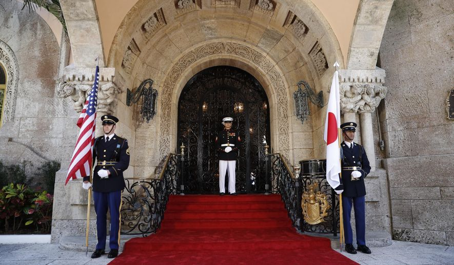 """FILE - In this April 17, 2018, file phot, military members get into place before President Donald Trump welcomes Japanese Prime Minister Shinzo Abe to Trump's private Mar-a-Lago in Palm Beach, Fla. rump is making his return to Florida, kicking off the Palm Beach social season at his """"winter White House."""" All presidents have had their favorite refuges from Washington. But none has drawn the fascination or raised the ethical issues of Mar-a-Lago, where Trump spends his days mixing work, business and play in the company of dues-paying members and staff are on high alert for those seeking influence. (AP Photo/Pablo Martinez Monsivais, file)"""