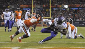 Minnesota Vikings wide receiver Aldrick Robinson (17) makes a touchdown reception against Chicago Bears linebacker Danny Trevathan (59) during the second half of an NFL football game Sunday, Nov. 18, 2018, in Chicago. (AP Photo/Mark Black)