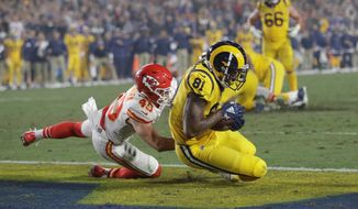 Los Angeles Rams tight end Gerald Everett scores a touchdown against the Kansas City Chiefs in Los Angeles' 54-51 win on Monday. The Rams and Chiefs combined for 105 points and 1,001 yards. The lead changed hands four times in the fourth quarter. (ASSOCIATED PRESS)
