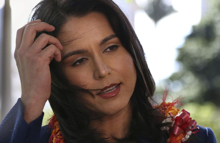 """U.S. Rep. Tulsi Gabbard endorses U.S. Rep. Coleen Hanabusa for Hawaii governor during a news conference on Wednesday, January 24, 2018 in Honolulu. Gabbard says that a """"failure of leadership"""" in the administration of incumbent Gov. David Ige affirms her belief that Hawaii desperately needs a strong governor. (AP Photo/Jennifer Sinco Kelleher)"""