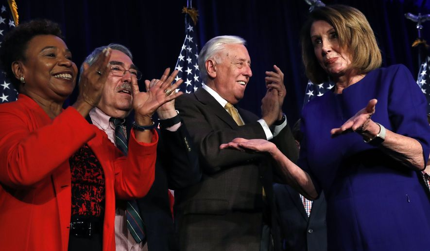 House Minority Leader Nancy Pelosi of Calif., right, dances to the music as she steps away from the podium past Rep. Barbara Lee, D-Calif., far left, Congressional Black Caucus Chairman Rep. G.K. Butterfield, D-N.C., and House Minority Whip Steny Hoyer, D-Md., after speaking about Democratic wins in the House of Representatives to a crowd of Democratic supporters during an election night returns event at the Hyatt Regency Hotel, on Tuesday, Nov. 6, 2018, in Washington. (AP Photo/Jacquelyn Martin)
