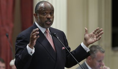 FILE - In this Sept. 9, 2013, file photo, state Sen. Roderick Wright, D-Inglewood, speaks at the Capitol in Sacramento, Calif. The California Supreme Court is recommending that Gov. Jerry Brown pardon a former state lawmaker convicted of lying about his true residence. A Los Angeles County jury in 2014 determined that Wright lived outside the district he represented and convicted him of voter fraud and perjury. The recommendation by justices on Tuesday, Nov. 20, 2018, came after the governor's legal affairs secretary, Peter Krause, sought the court's input. (AP Photo/Rich Pedroncelli, File)