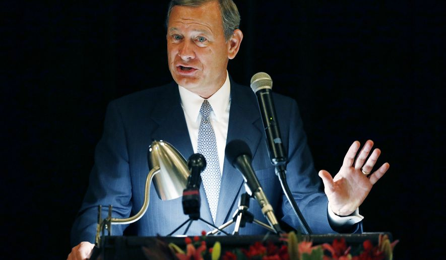 In this Sept. 27, 2017 file photo, Chief Justice John Roberts speaks during the Bicentennial of Mississippi's Judiciary and Legal Profession Banquet in Jackson, Miss. Roberts is pushing back against President Donald Trumps description of a judge who ruled against the administrations new asylum policy as an Obama judge. Its the first time that the leader of the federal judiciary has offered even a hint of criticism of Trump, who has previously blasted federal judges who ruled against him.  Roberts says Wednesday that the U.S. doesnt have Obama judges or Trump judges, Bush judges or Clinton judges. He is commenting in a statement released by the Supreme Court after a query by The Associated Press. (AP Photo/Rogelio V. Solis) **FILE**