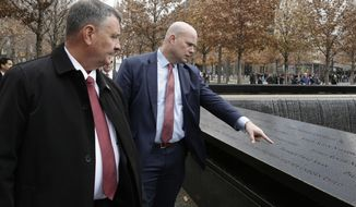 Acting U.S. Attorney General Matthew Whitaker, center, tours the 9/11 Memorial & Museum on Wednesday, Nov. 21, 2018 in New York. Before joining the Justice Department, Whitaker earned nearly $1 million from a right-leaning nonprofit that doesn't disclose its donors, according to financial disclosure forms released Tuesday. Lt. John Ryan of the Port Authority Police Department is at left. (AP Photo/Peter Morgan)