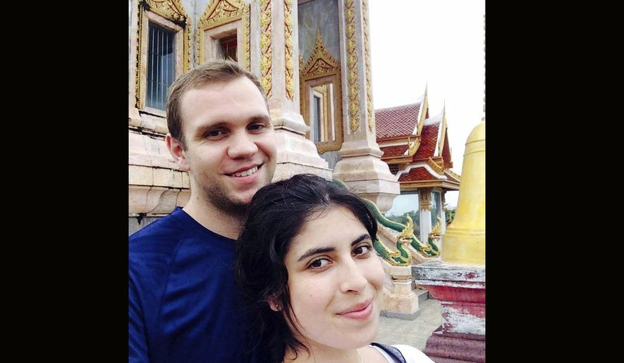 This undated family handout photo shows Matthew Hedges with his wife Daniela Tejada. The family of a British academic jailed in the United Arab Emirates on spying allegations says he's been sentenced to life in prison. Matthew Hedges, a 31-year-old PhD student in Middle Eastern Studies at Durham University, was arrested at Dubai Airport on May 5, 2018. Foreign Secretary Jeremy Hunt expressed shock at the verdict Wednesday Nov. 21, 2018 and has travelled to the UAE to make representations on his behalf. (Daniela Tejada via AP)
