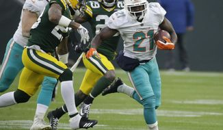 FILE - In this  Sunday, Nov. 11, 2018 file photo, Miami Dolphins' Frank Gore runs during the first half of an NFL football game against the Green Bay Packers in Green Bay, Wis. No hard feelings, but ageless running back Frank Gore is looking forward to facing his former team Sunday when the Dolphins play at Indianapolis. Gore played for the Colts last season, and at 35 he has no plans to retire. (AP Photo/Mike Roemer, File)
