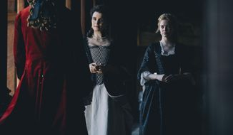 "This image released by Fox Searchlight Films shows Rachel Weisz and Emma Stone, right, in a scene from the film ""The Favourite.""  (Atsushi Nishijima/Fox Searchlight Films via AP)"