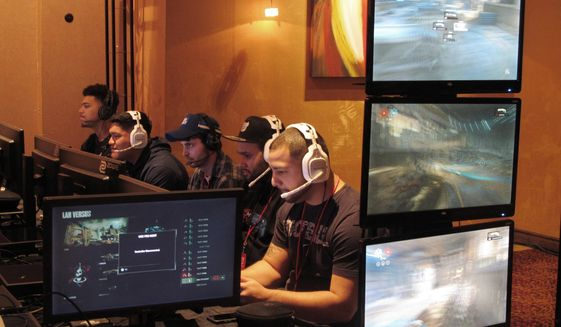 In this March 31, 2017, file photo, video game players compete against one another in an esports tournament at Caesars casino in Atlantic City, N.J. (AP Photo/Wayne Parry, File) **FILE((