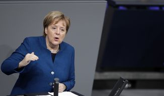 German Chancellor Angela Merkel delivers a speech during the budget debate of the German federal parliament, Bundestag, at the Reichstag building in Berlin, Germany, Wednesday, Nov. 21, 2018. (AP Photo/Michael Sohn)