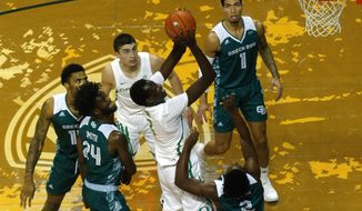 Oregon center Bol Bol goes up as teammate Payton Pritchard (3) watches along with Green Bay's Sandy Cohen III (1), PJ Pipes (2) and Jevon Smith (24) during the first half of their 2K Empire Classic NCAA college basketball game, Tuesday, Nov. 20 2018, in Eugene, Ore. (Andy Nelson/The Register-Guard via AP)