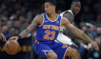 New York Knicks' Trey Burke (23) makes a move against Boston Celtics' Terry Rozier, right, during the first half on an NBA basketball game in Boston, Wednesday, Nov. 21, 2018. (AP Photo/Michael Dwyer)
