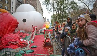 Crowds gather to see giant character balloons being inflated the night before their appearance in the 92nd Macy's Thanksgiving Day parade, Wednesday Nov. 21, 2018, in New York. (AP Photo/Bebeto Matthews)