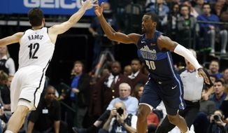 Dallas Mavericks forward Harrison Barnes (40) tips the ball away form Brooklyn Nets forward Joe Harris (12) during the first half of an NBA basketball game in Dallas, Wednesday, Nov. 21, 2018. (AP Photo/Michael Ainsworth)