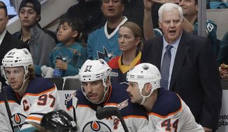 Edmonton Oilers head coach Ken Hitchcock, right, watches his team in action against the San Jose Sharks during the first period of an NHL hockey game in San Jose, Calif., Tuesday, Nov. 20, 2018. (AP Photo/Jeff Chiu)