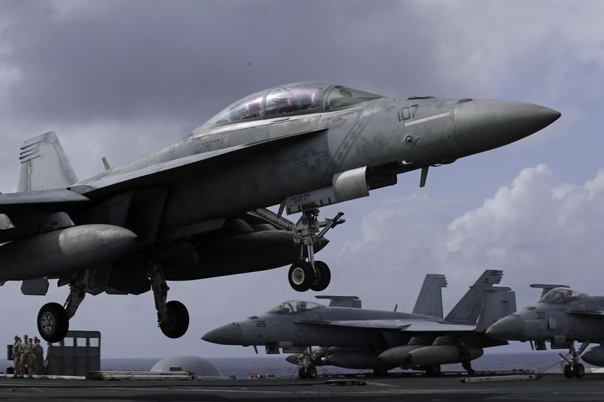 An F/A-18 Super Hornet fighter jet lands on the deck of the U.S. Navy USS Ronald Reagan in the South China Sea, Tuesday, Nov. 20, 2018. (AP Photo/Kin Cheung) ** FILE **