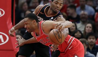 Chicago Bulls forward Jabari Parker, front, drives against Phoenix Suns forward T.J. Warren during the first half of an NBA basketball game Wednesday, Nov. 21, 2018, in Chicago. (AP Photo/Nam Y. Huh)