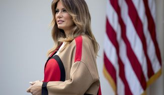First lady Melania Trump attends a ceremony to pardon the National Thanksgiving Turkey in the Rose Garden of the White House in Washington, Tuesday, Nov. 20, 2018. (AP Photo/Andrew Harnik)