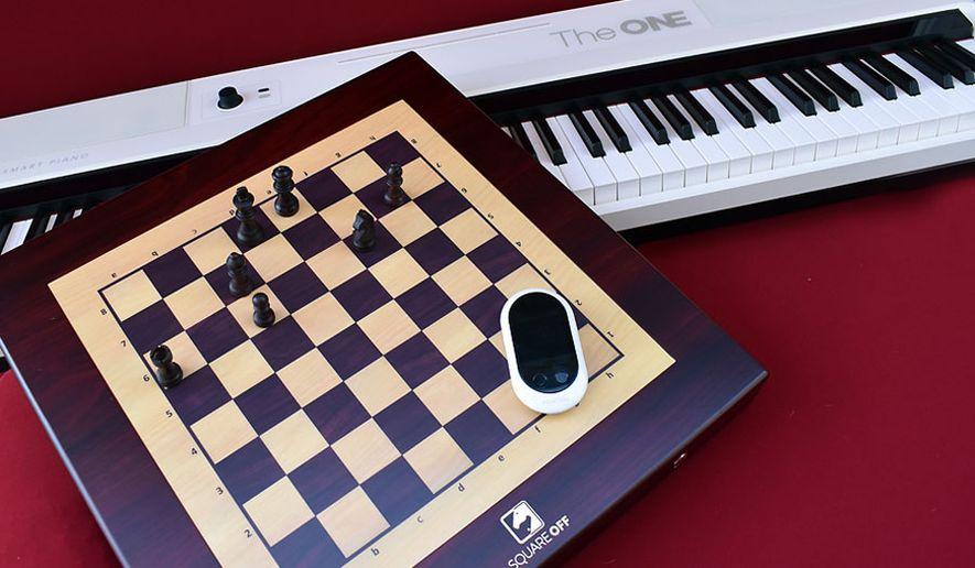 Telerobotics' Square Off, One Music Group's One Pro and Sourcenext's Pocketalk (Photograph by Joseph Szadkowski / The Washington Times)