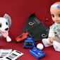 Spin Master's Zoomer and Boxer (center), PowerUp Toys' X-FPV and Hasbro's Baby Alive. (Photograph by Joseph Szadkowski / The Washington Times)