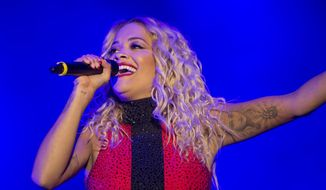 """The British singer Rita Ora appeared out of sync with the vocals that viewers heard during parts of her televised performance of """"Let You Love Me.""""  (Associated Press photograph)"""