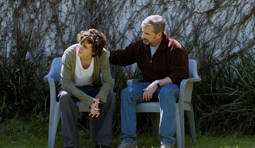 """This image released by Amazon Studios shows Timothée Chalamet, left, and Steve Carell in a scene from """"Beautiful Boy."""" (Francois Duhamel/Amazon Studios via AP)"""