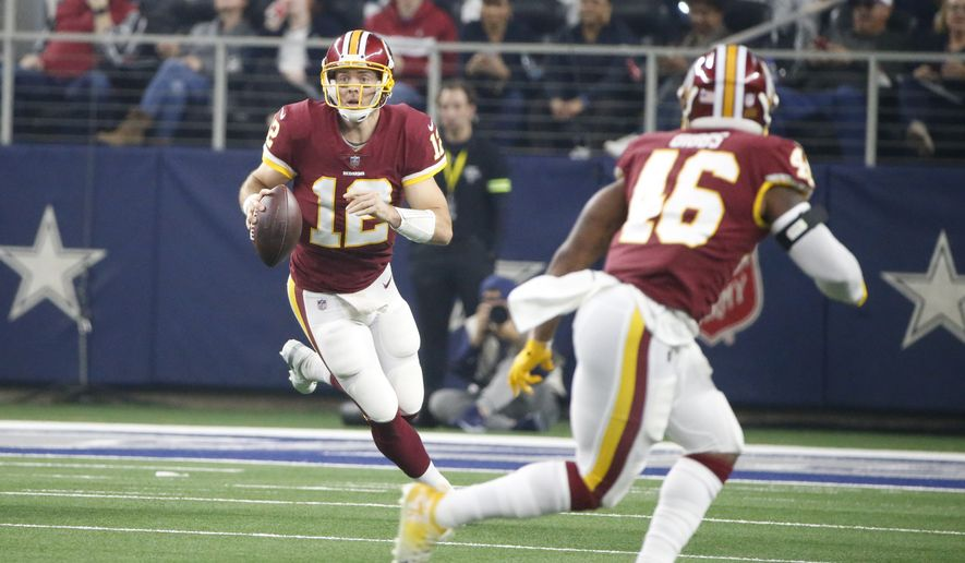 Washington Redskins quarterback Colt McCoy (12) looks to throw against the Dallas Cowboys during the first half of an NFL football game in Arlington, Texas, Thursday, Nov. 22, 2018. (AP Photo/Michael Ainsworth)