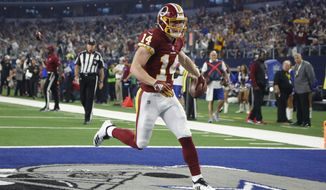 Washington Redskins wide receiver Trey Quinn (14) scores a touchdown against the Dallas Cowboys during the second half of an NFL football game in Arlington, Texas, Thursday, Nov. 22, 2018. (AP Photo/Michael Ainsworth) ** FILE **