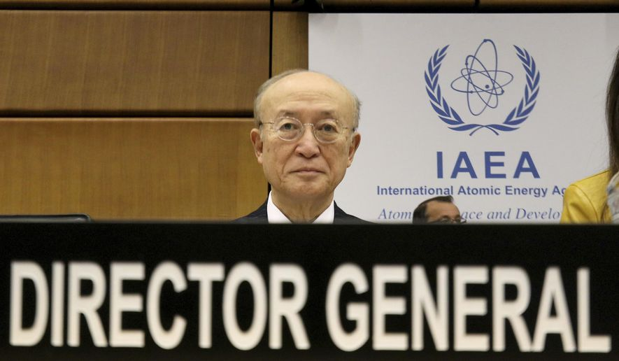 Director General of the International Atomic Energy Agency, IAEA, Yukiya Amano of Japan waits for the start of the IAEA board of governors meeting at the International Center in Vienna, Austria, Thursday, Nov. 22, 2018. (AP Photo/Ronald Zak)