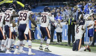The Chicago Bears celebrate after cornerback Kyle Fuller intercepted a pass in the end zone intended for Detroit Lions tight end Michael Roberts during the second half of an NFL football game, Thursday, Nov. 22, 2018, in Detroit. (AP Photo/Duane Burleson)