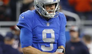 Detroit Lions quarterback Matthew Stafford reacts after throwing an incomplete pass during the second half of an NFL football game against the Chicago Bears, Thursday, Nov. 22, 2018, in Detroit. (AP Photo/Paul Sancya)