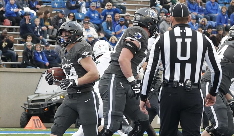 Air Force fullback Cole Fagan, left, scores a touchdown against Colorado State in the first half of an NCAA college football game Thursday, Nov. 22, 2018, at Air Force Academy, Colo. (AP Photo/David Zalubowski)