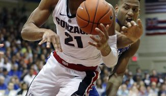 Duke forward Javin DeLaurier (12) smacks the ball out of the hands of Gonzaga forward Rui Hachimura (21) during the second half of an NCAA college basketball game at the Maui Invitational, Wednesday, Nov. 21, 2018, in Lahaina, Hawaii. Gonzaga defeated Duke 89-87. (AP Photo/Marco Garcia)