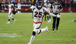 FILE- In this Oct. 18, 2018, file Denver Broncos cornerback Chris Harris Jr. (25) celebrates his interception for a touchdown against the Arizona Cardinals during the first half of an NFL football game in Glendale, Ariz. When they take the field Sunday, Nov. 25, Harris will have waited 1,072 days for his rematch with Pittsburgh Steelers receiver Antonio Brown. (AP Photo/Rick Scuteri, File)