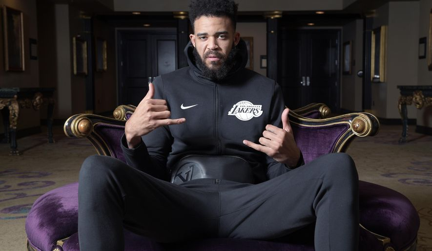 Los Angeles Lakers center JaVale McGee sits for a portrait after NBA basketball practice Friday, Nov. 16, 2018, in Orlando, Fla. McGee is a very diverse person away from the court. He makes music on his computer and is serious about that as a vocation. He's devoted to philanthropy, having built some wells to bring clean water to parts of Uganda. (AP Photo/Phelan M. Ebenhack)