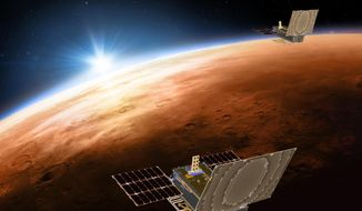 This illustration made available by NASA in March 2018 shows the twin Mars Cube One project (MarCO) spacecrafts flying over Mars with Earth and the sun in the distance. The MarCOs will be the first CubeSats, a kind of modular, mini-satellite, flown into deep space. They're designed to fly along behind NASA's InSight lander on its cruise to Mars. (NASA/JPL-Caltech via AP)